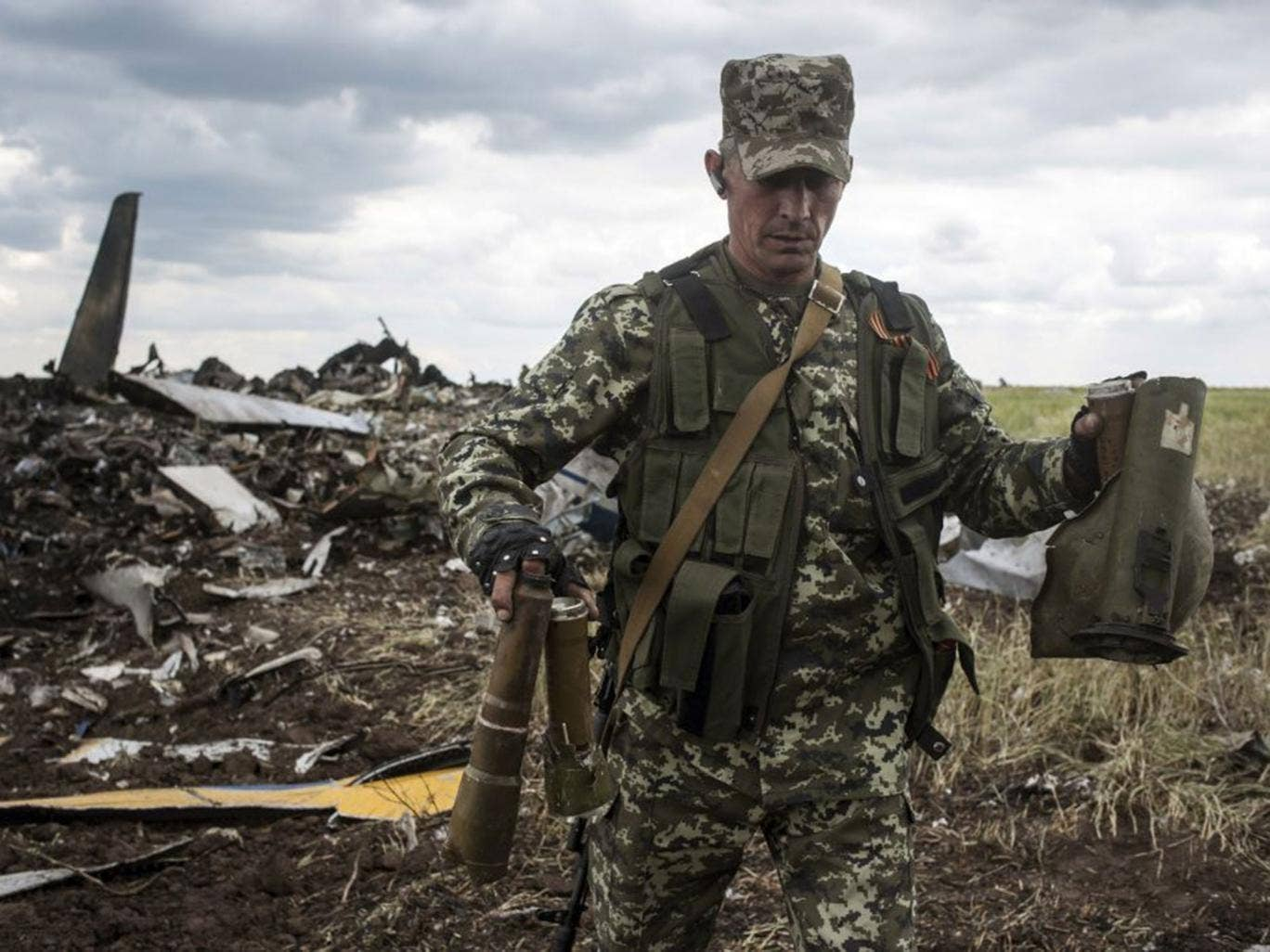A pro-Russian fighter with remnants of the Ukrainian plane shot down