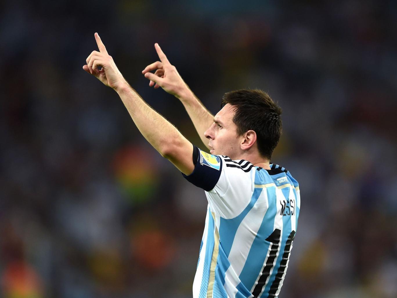 Lionel Messi celebrates scoring Argentina's second goal