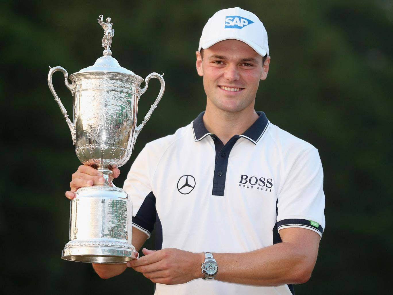 Martin Kaymer holds the trophy after his US Open triumph