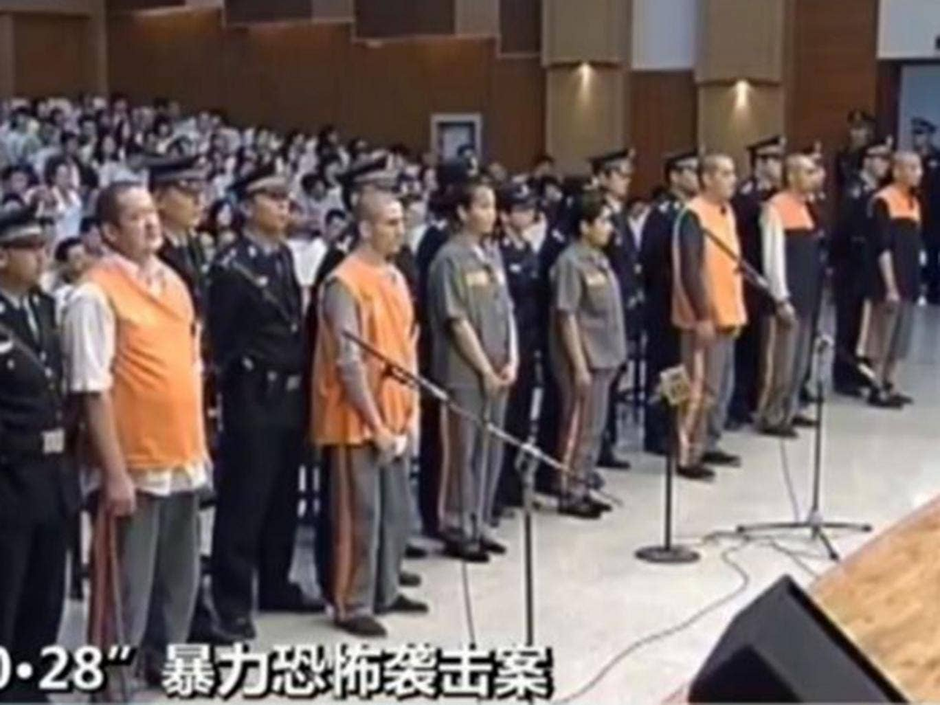 This screen grab taken from China Central Television shows  the prisoners upon their arrival at the Intermediate People's Court in the Xinjiang capital, Urumqi