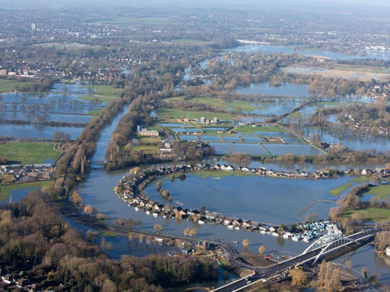 MPs argued maintaining flood protection for vulnerable communities such as Walton-on-Thames, pictured, should take priority over cost-cutting