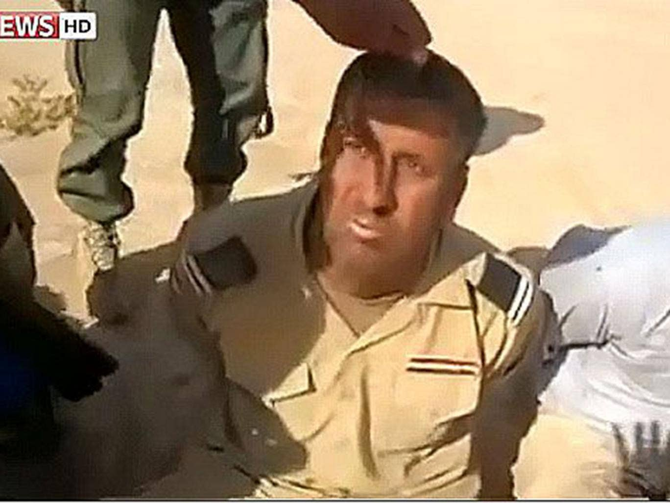 One Iraqi captive, a corporal, is reluctant to say the slogan, and has to be shouted at repeatedly before he obeys