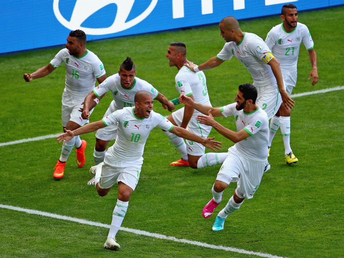 Sofiane Feghouli of Algeria celebrates with his teammates