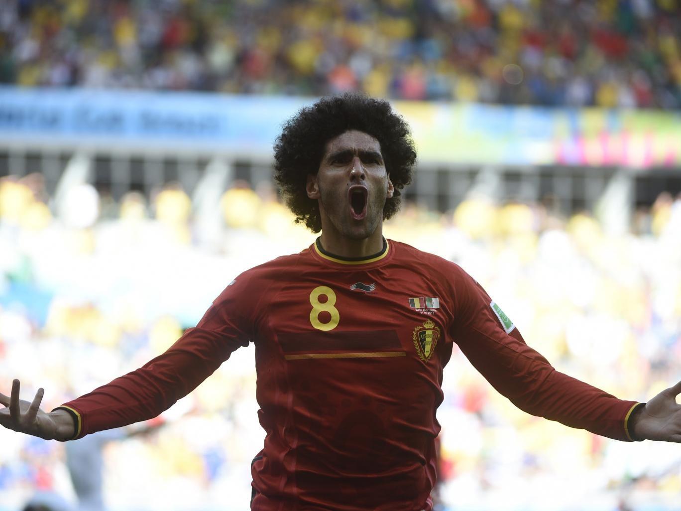 Marouane Fellaini celebrates bringing the scores level