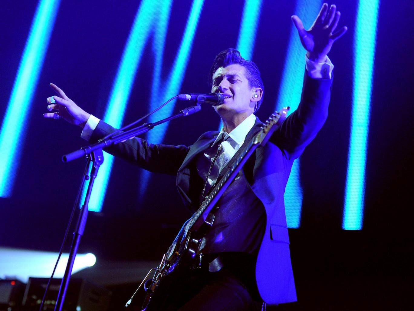 Musician Alex Turner of Arctic Monkeys performs onstage during The 24th Annual KROQ Almost Acoustic Christmas at The Shrine Auditorium on December 7, 2013 in Los Angeles, California.