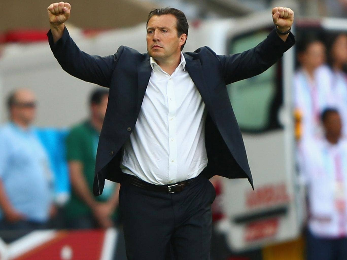 Belgium coach Marc Wilmots celebrates their 2-1 victory over Algeria