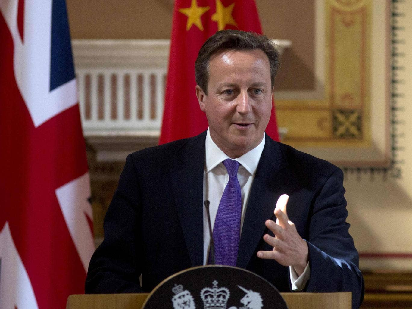 Prime Minister David Cameron speaks during a news conference in London 17 June, 2014