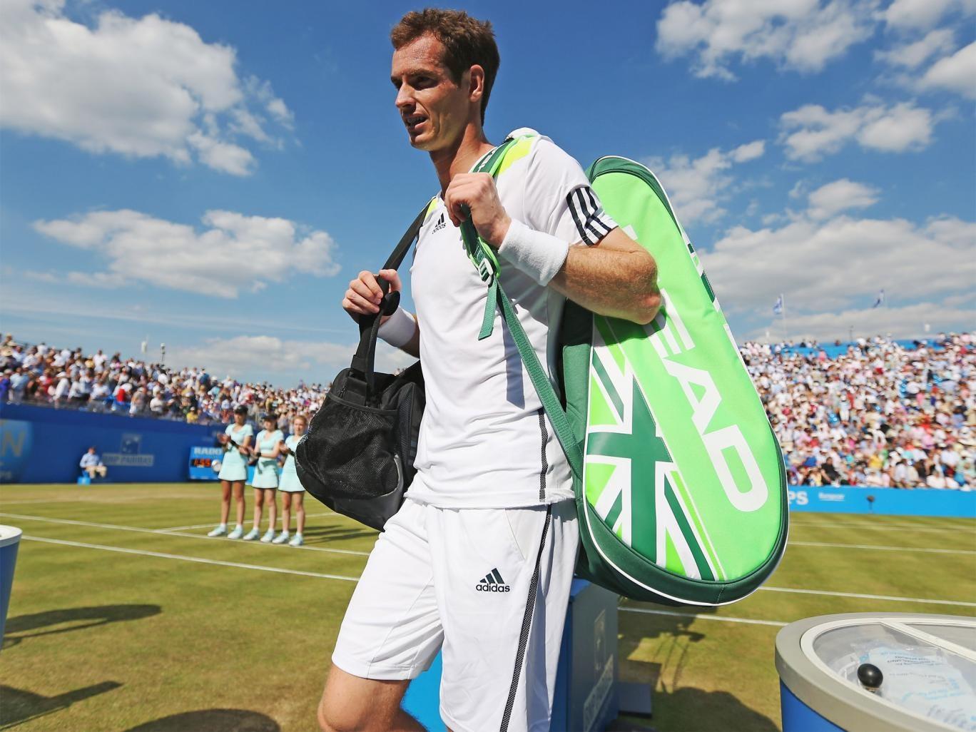 Andy Murray leaves the court following his defeat against Radek Stepanek at Queens last week
