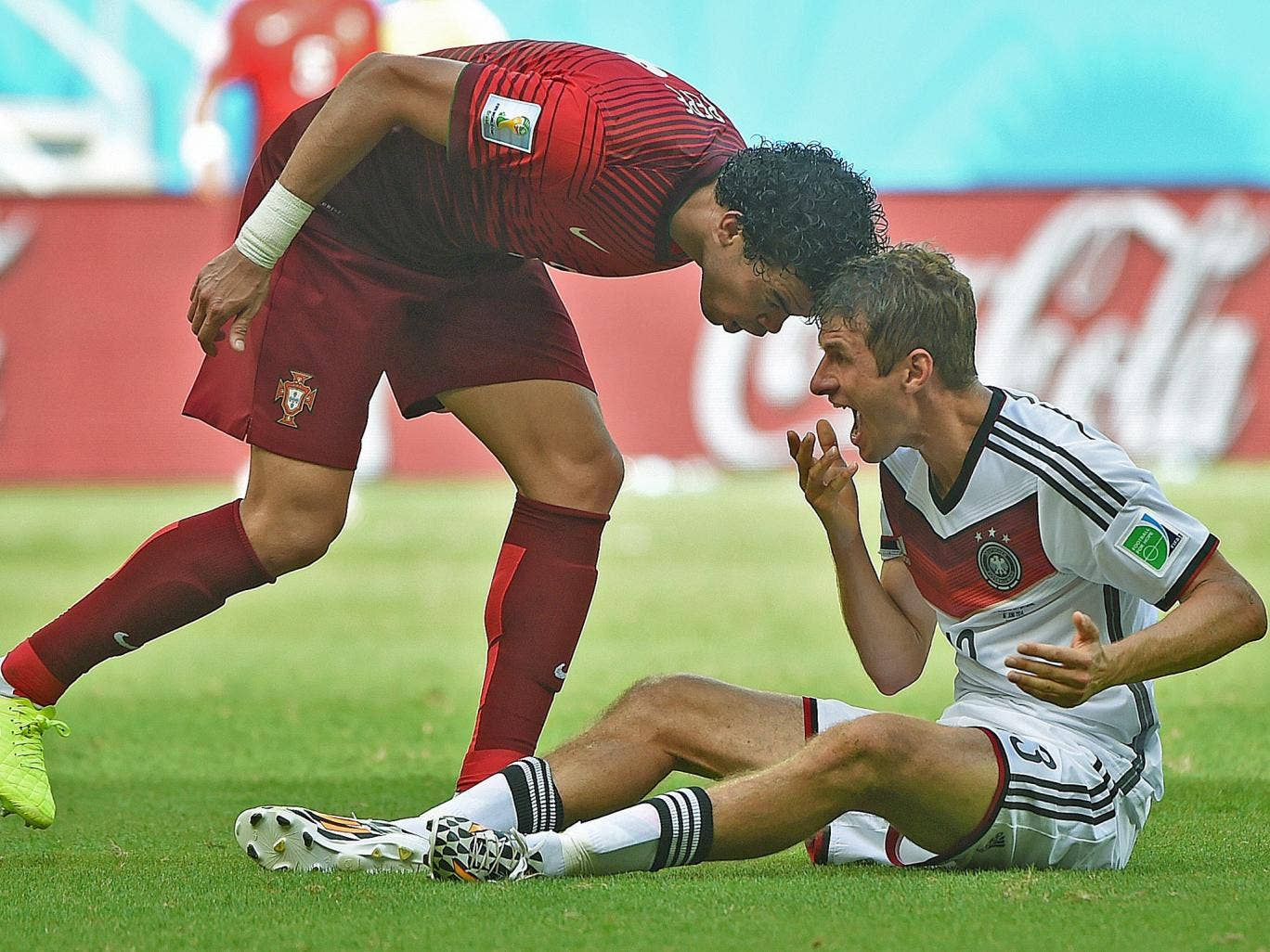 Call that a head-butt? Pepe sins by placing his head on Thomas Müller's for which he is promptly sent off