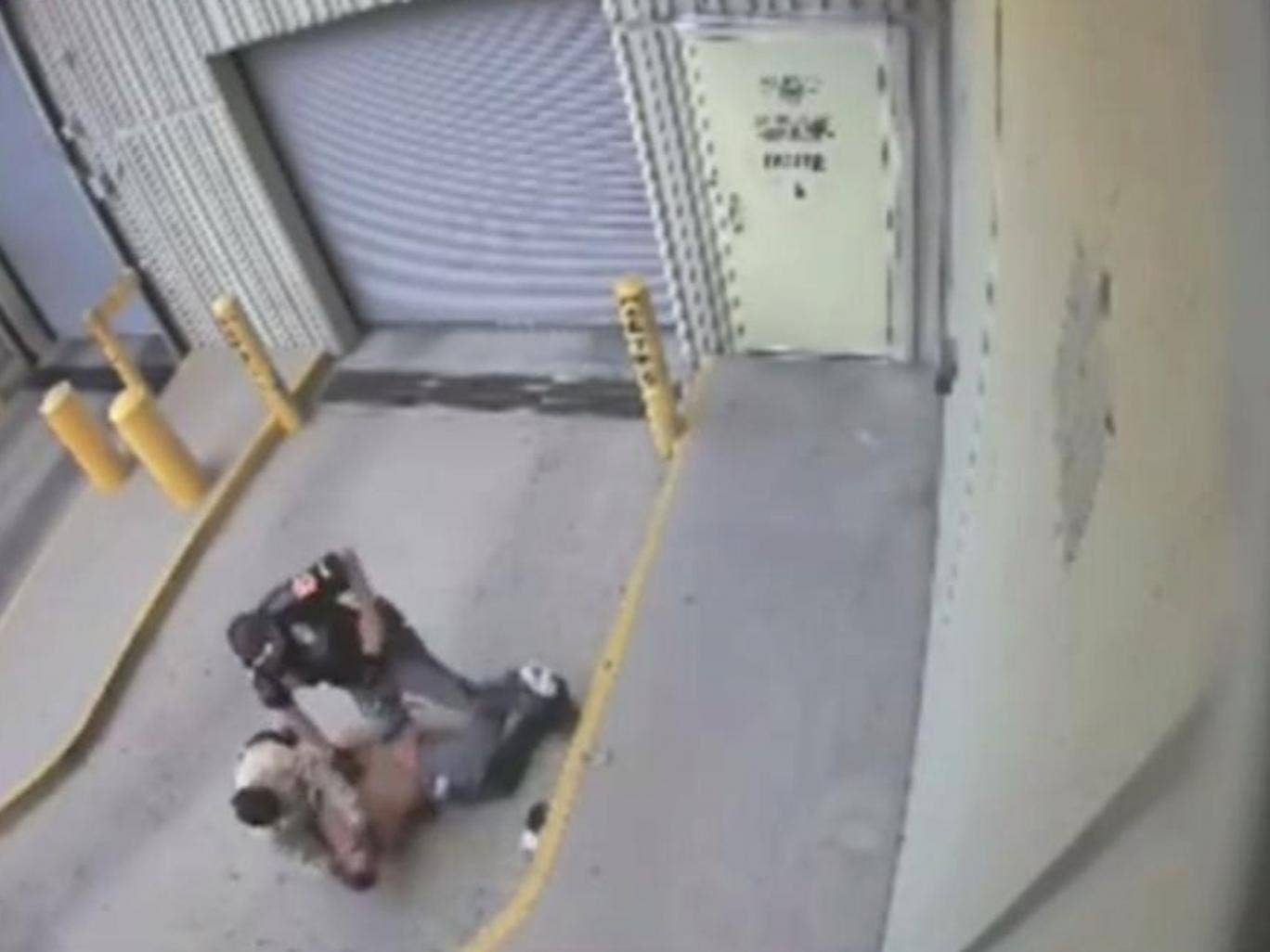 Graphic video footage has emerged of the moment a policeman shot and fatally wounded a handcuffed prisoner being restrained on the floor in El Paso City jail.
