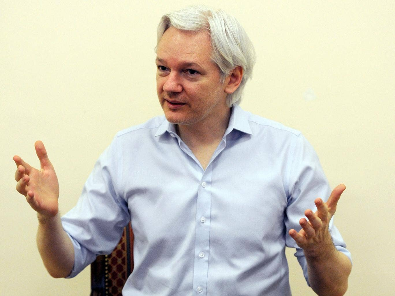 Wikileaks founder Julian Assange speaks to the media inside the Ecuadorian Embassy in London on 14 June, 2013, ahead of the first anniversary of his arrival there on 19 June, 2012