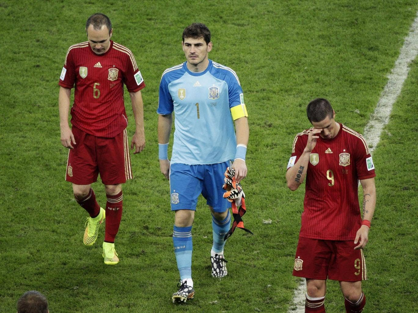 From left; Spain's Andres Iniesta, goalkeeper Iker Casillas and Fernando Torres trudge off the pitch at the Maracana on Wednesday night