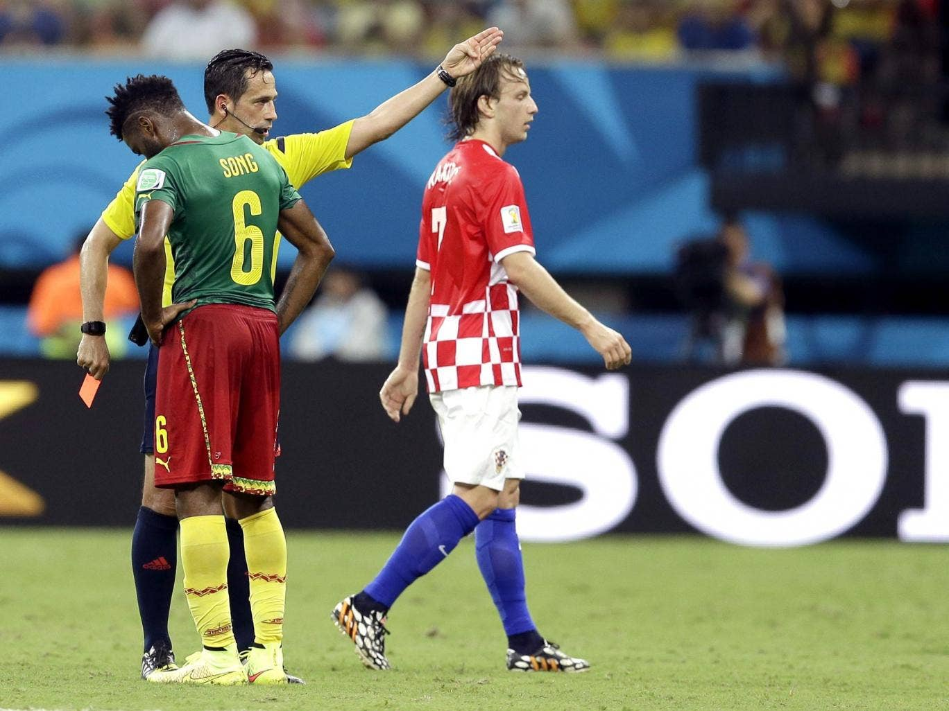 Cameroon's Alex Song is given a red card