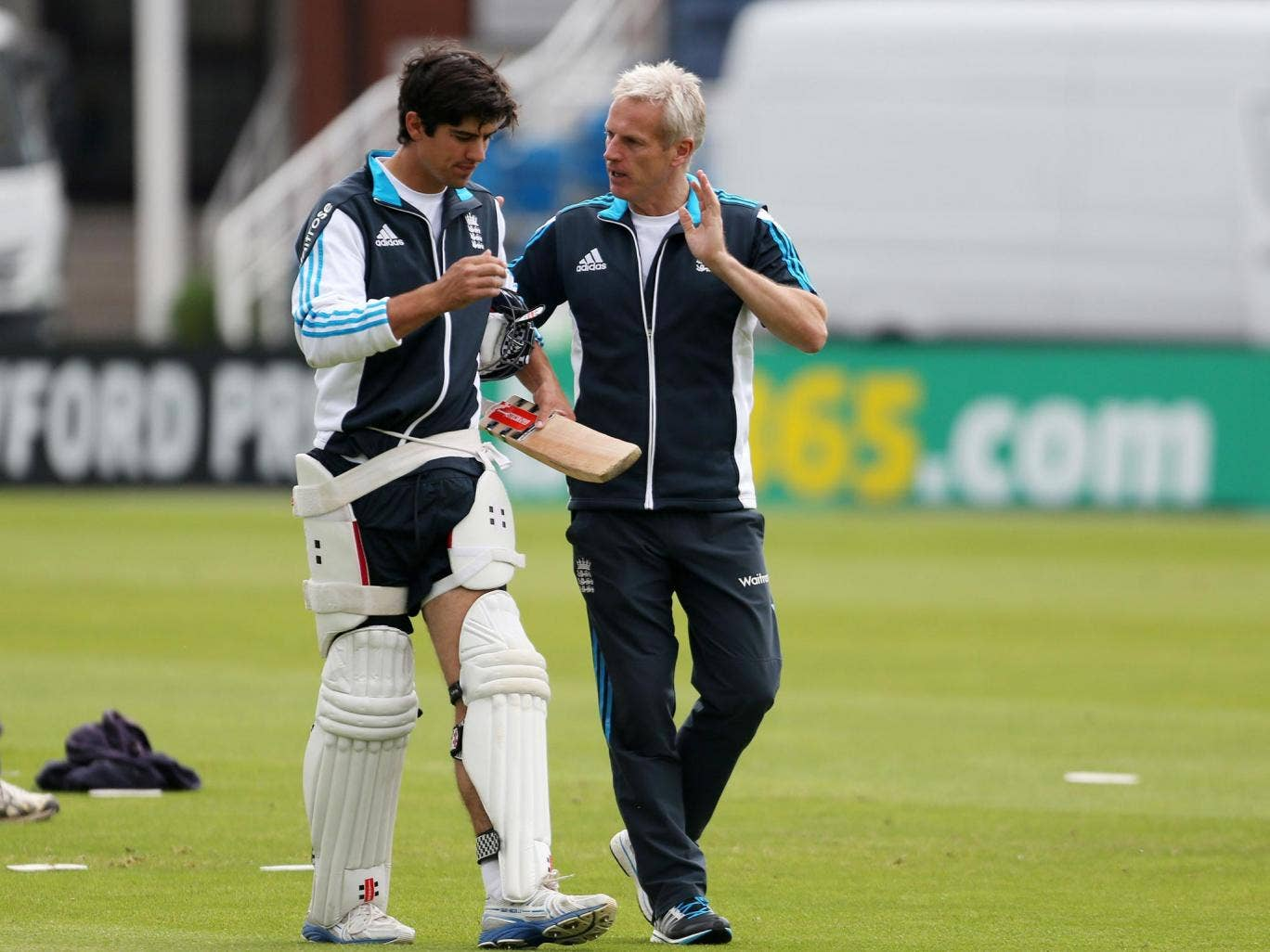 England captain Alastair Cook (left), who has gone 22 innings without a Test century, speaks with the coach, Peter Moores, at Headingley yesterday