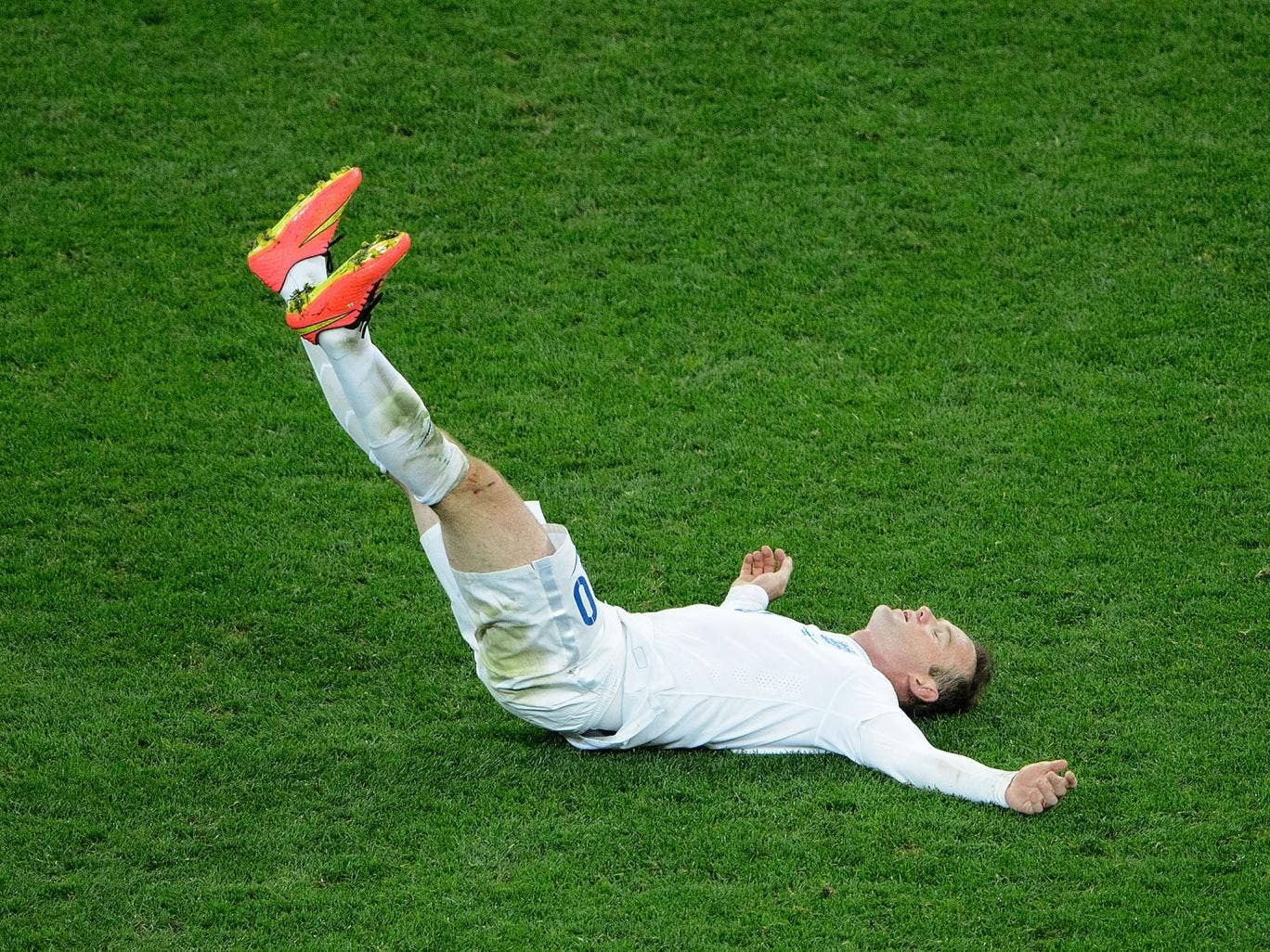Down and out, Wayne Rooney slumps to the ground after England's 2-1 defeat to Uruguay