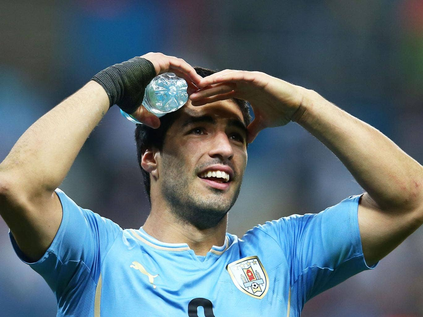 Luis Suarez looks towards the crowd during the 2-1 victory over England