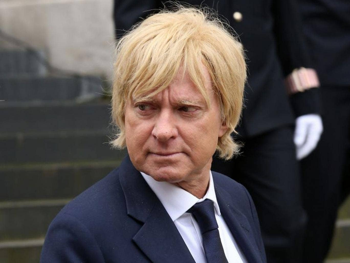 (FILE PHOTO) FILE - Conservative MP Michael Fabricant Apologies For 'Punch Journalist' Joke Tweeter Remark. LONDON, ENGLAND - APRIL 17:  MP Michael Fabricant attends the Ceremonial funeral of former British Prime Minister Baroness Thatcher at St Paul's Ca