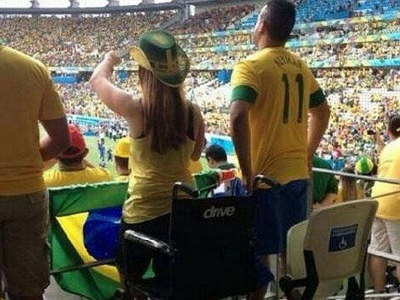 Police are investigating pictures of fans apparently standing out of wheelchairs at Brazil's match against Croatia.