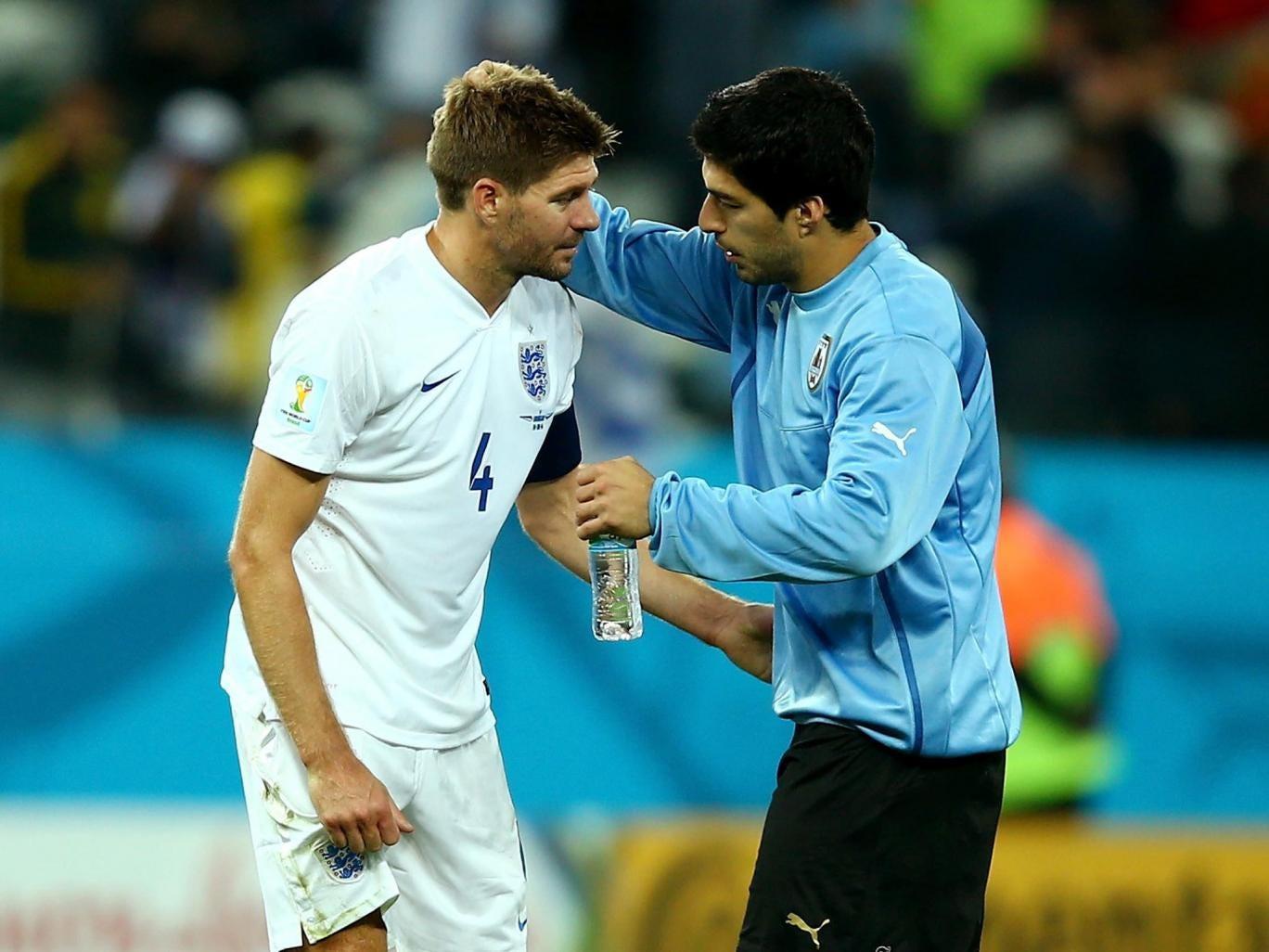 Luis Suarez consoles Steven Gerrard after England's defeat against Uruguay