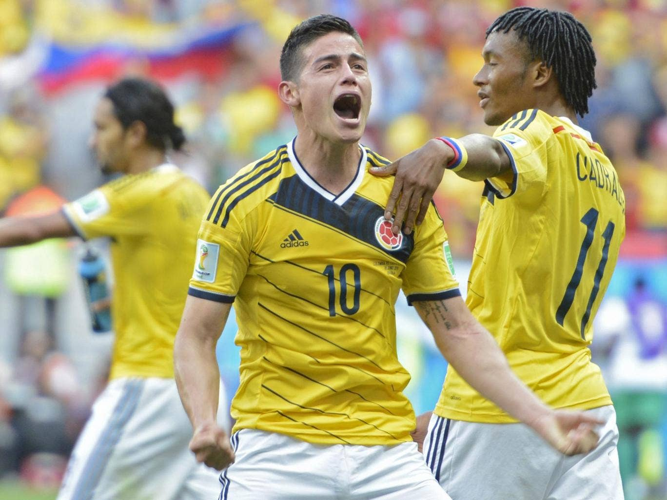 James Rodriguez (centre) celebrates after scoring Colombia's first goal in their 2-1 win over Ivory Coast