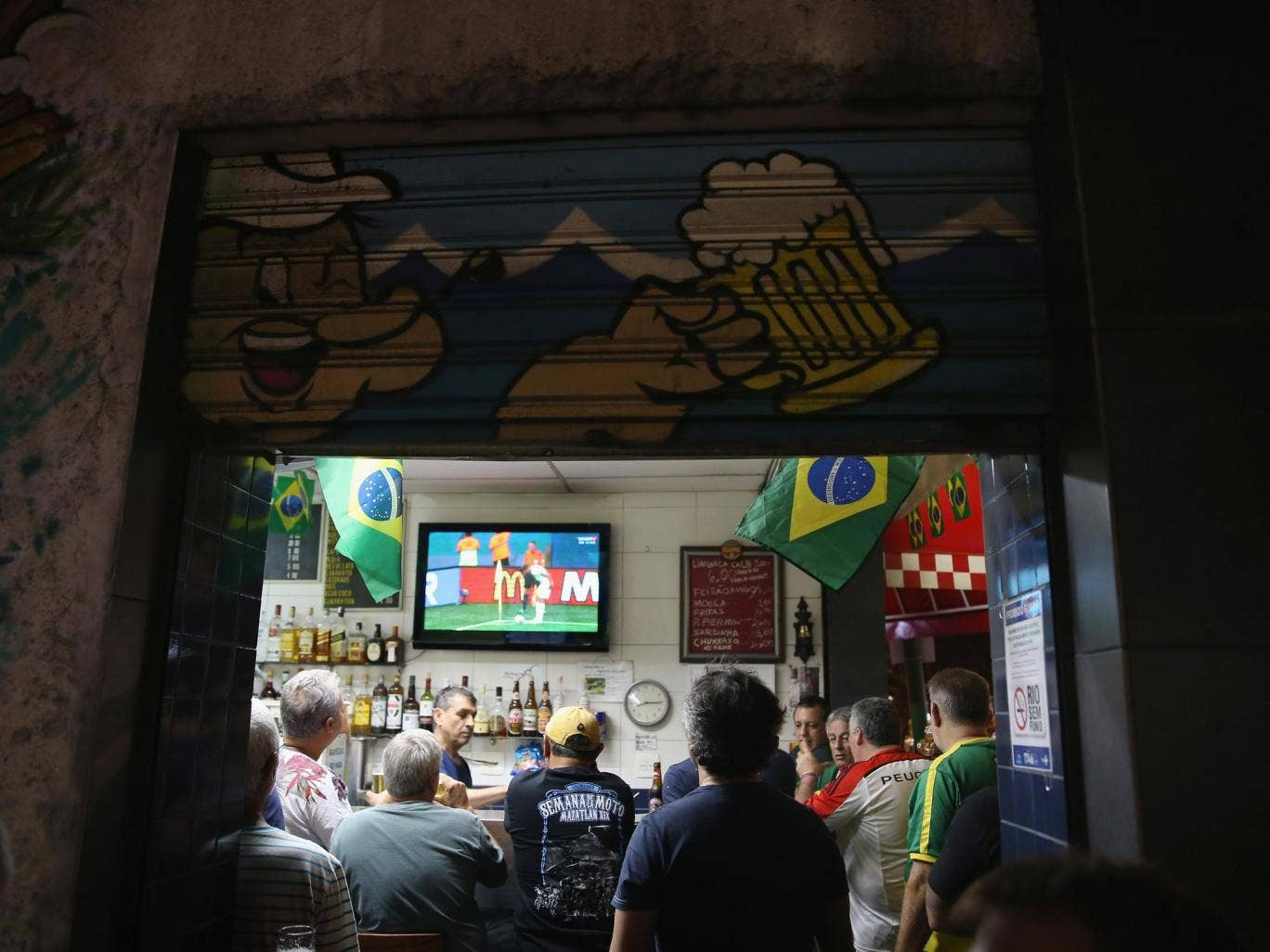 Fans watch and argue over World Cup coverage in a bar in Brazil
