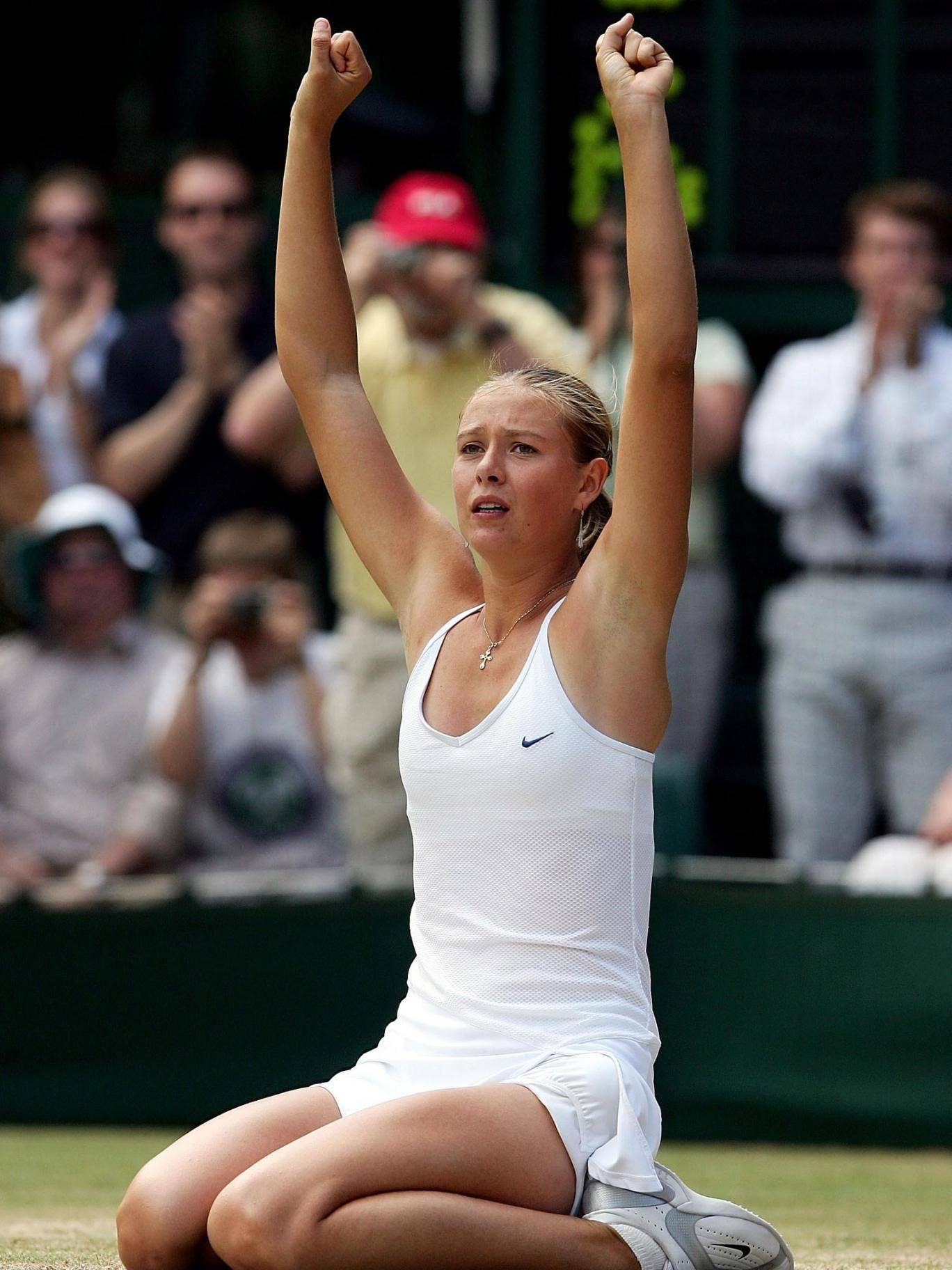 Maria Sharapova sinks to her knees after winning the 2004 Wimbledon final against Serena Williams