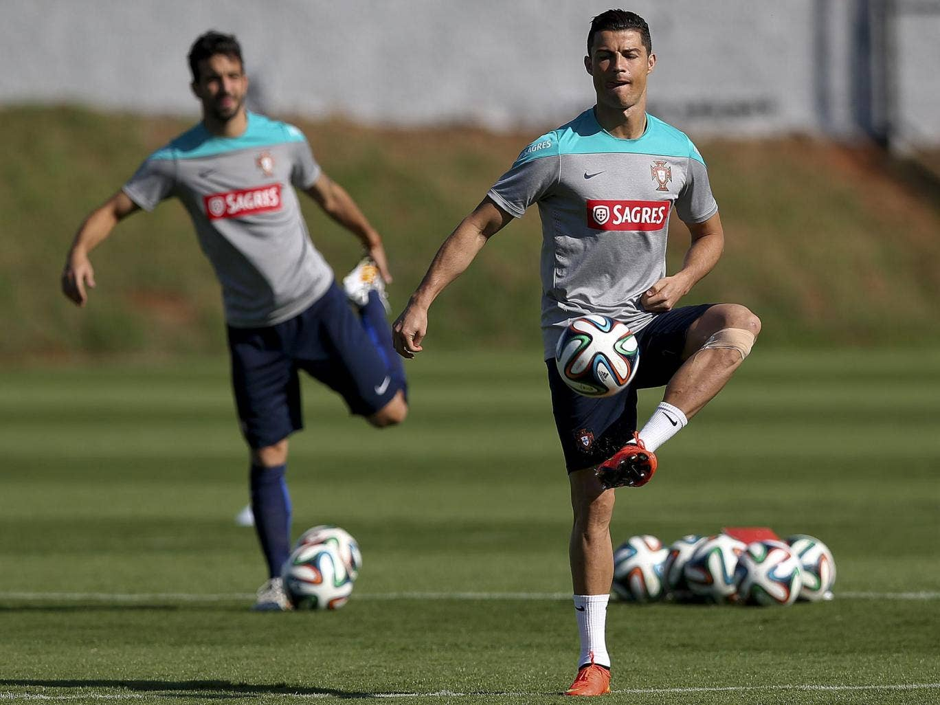 Cristiano Ronaldo during training yesterday, with his left knee strapped up