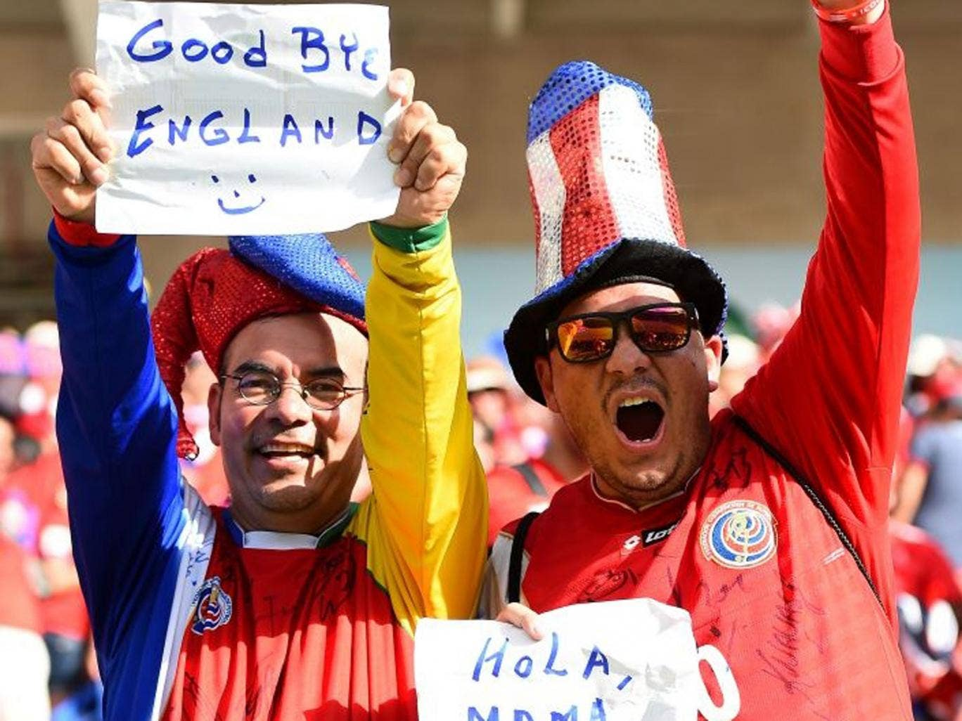 """A Costa Rica fan holds up a sign reading """"Good Bye England"""" during the 2014 FIFA World Cup Brazil Group D match between Italy and Costa Rica at Arena Pernambuco on June 20, 2014 in Recife, Brazil."""