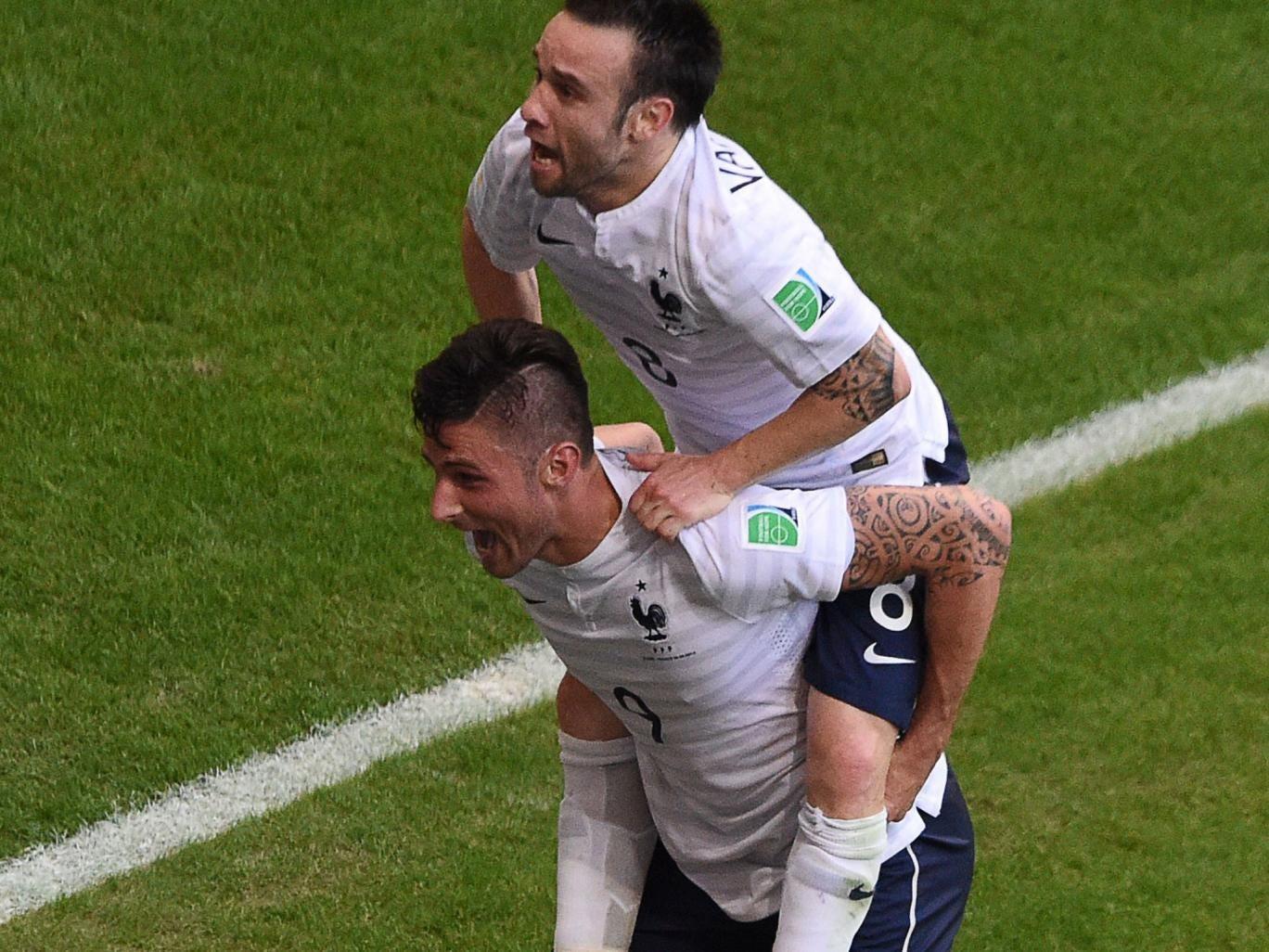 Mathieu Valbuena celebrates with Olivier Giroud