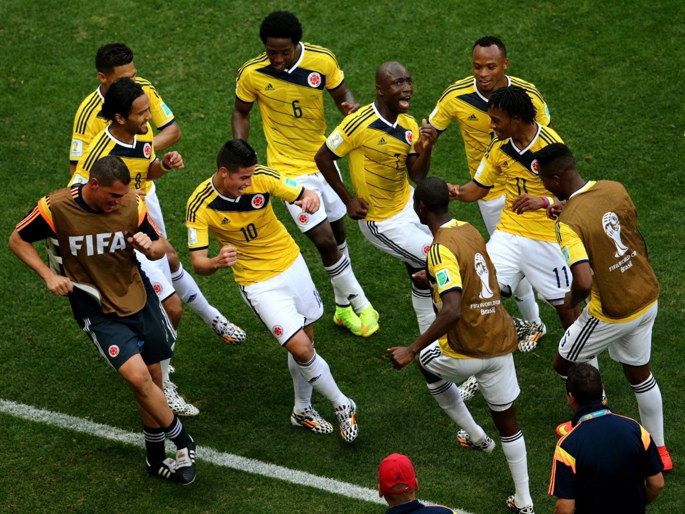 James Rodriguez celebrates scoring for Colombia