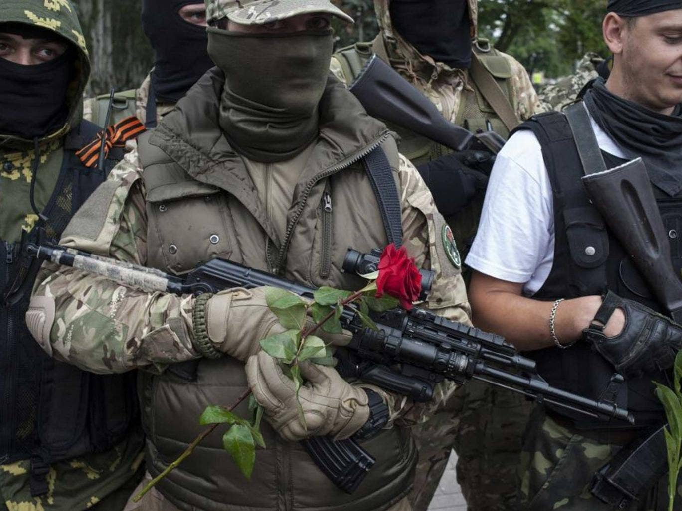 Pro-Russian fighters in Donetsk yesterday taking an oath of allegiance to the new 'republic'