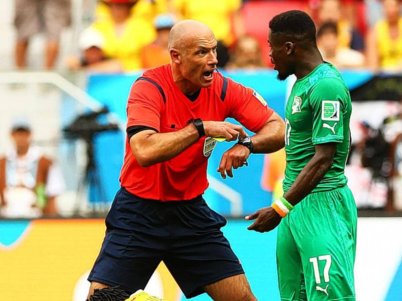 Time's up: England's Howard Webb gets his point across in Brazil