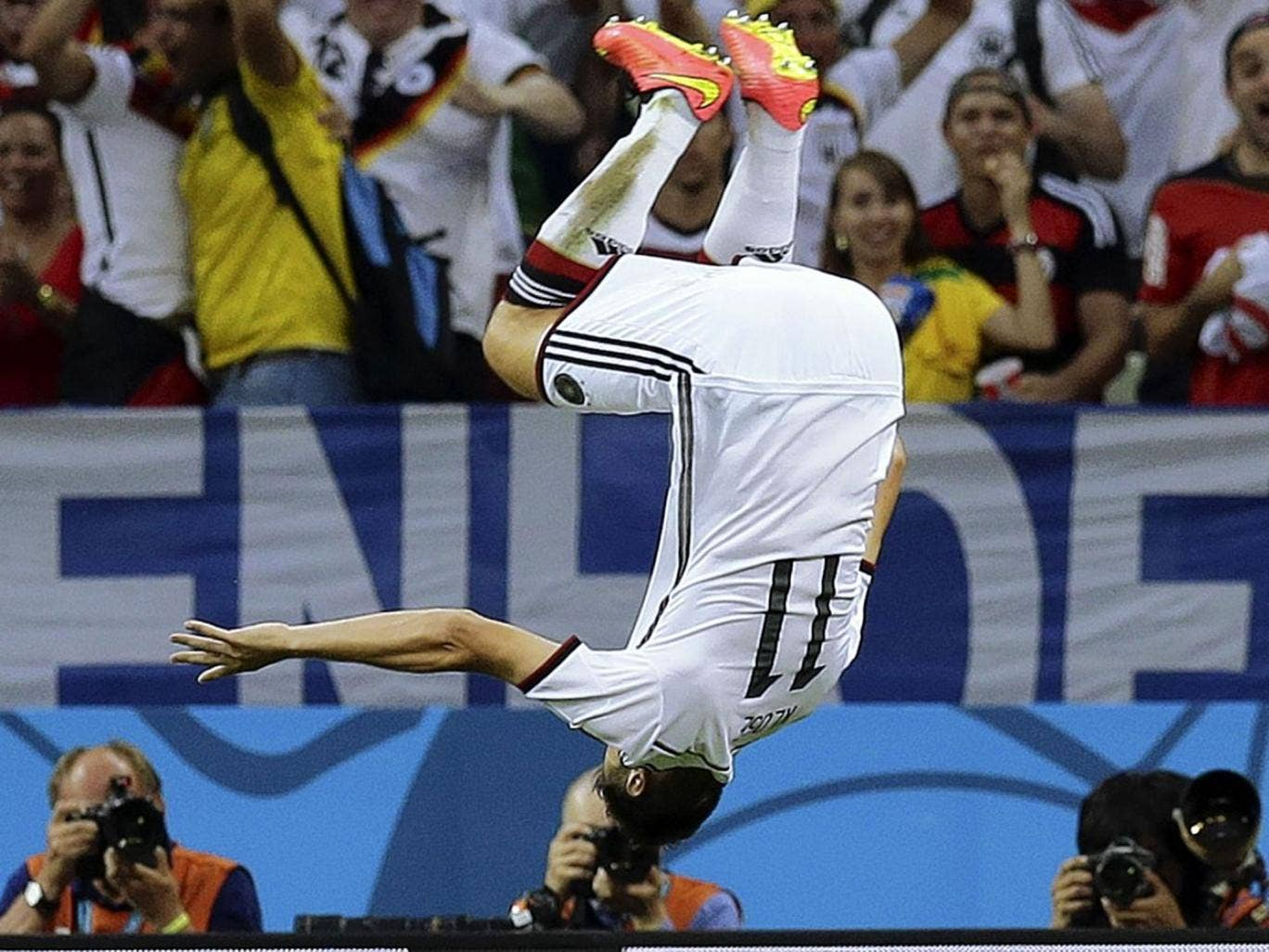 Vorsprung durch Klose: Germany's veteran striker Miroslav Klose does a flying somersault to celebrate his equaliser