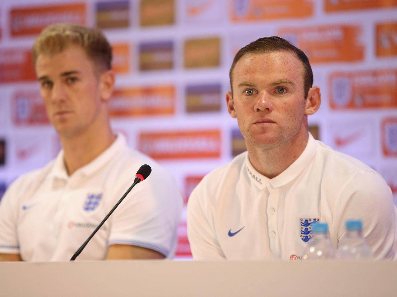 Joe Hart and Wayne Rooney face the media in a press conference after an England training session at the Urca Military Base on June 21, 2014 in Rio de Janeiro, Brazil