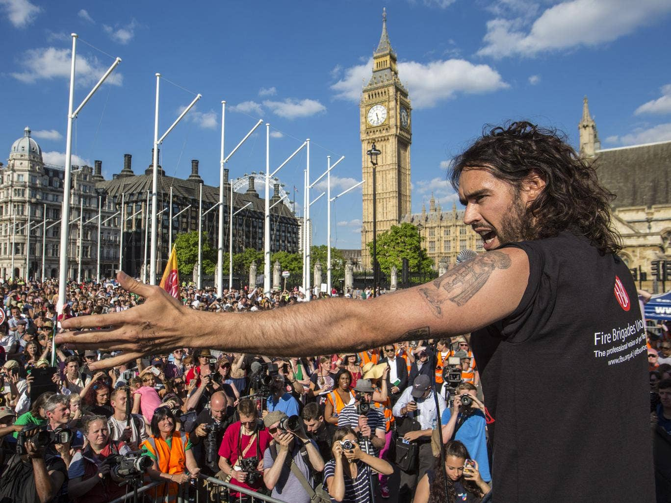 Russell Brand wore a t-shirt which read: 'Firefighters rescue people not bankers'