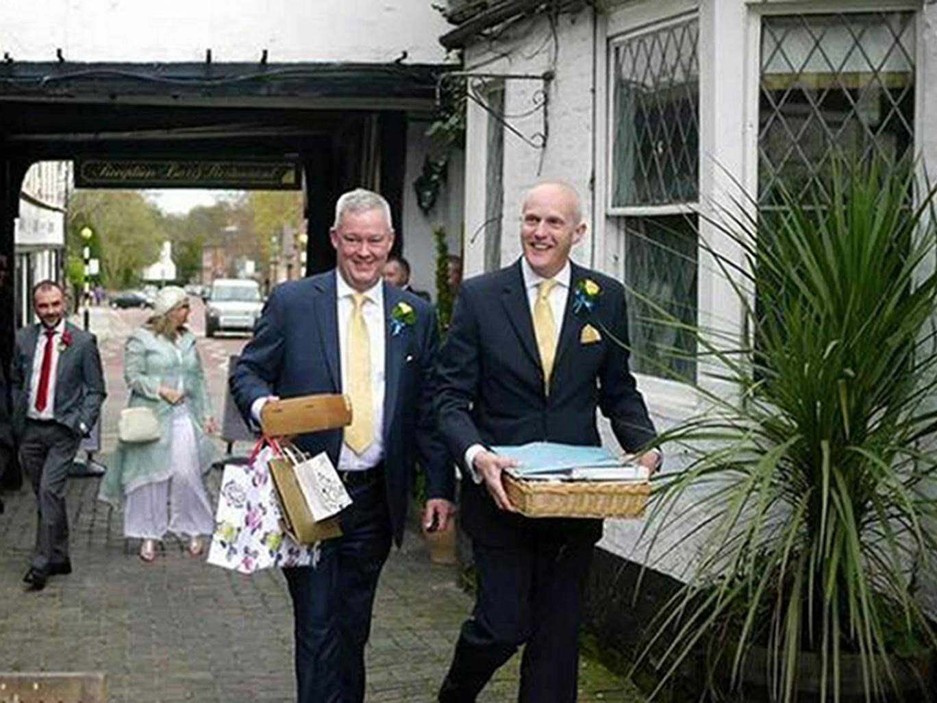 Canon Jeremy Pemberton, left, with Laurence Cunnington, right, after their marriage in April 2014