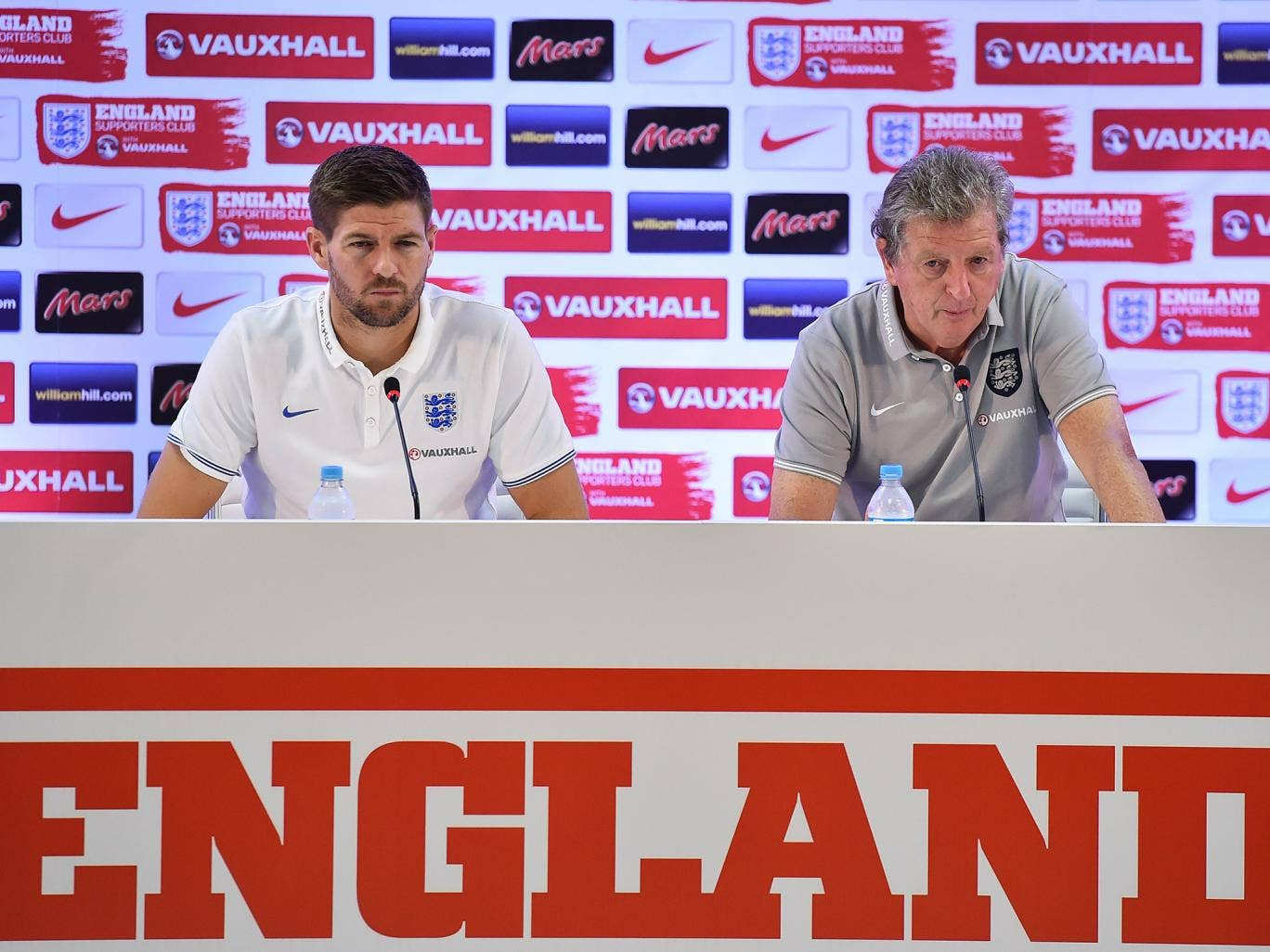 Steven Gerrard speaks to the media alongside Roy Hodgson