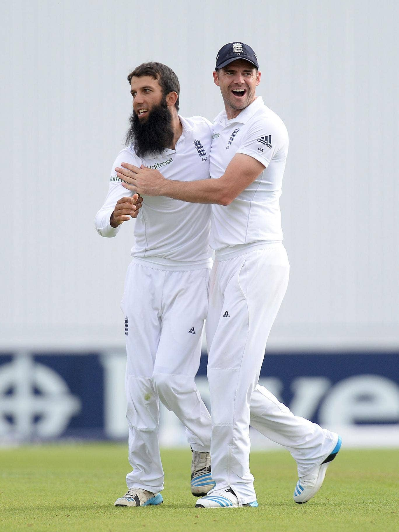 Moeen Ali, left, celebrates with James Anderson after taking the wicket of Sri Lanka's Lahiru Thirimanne