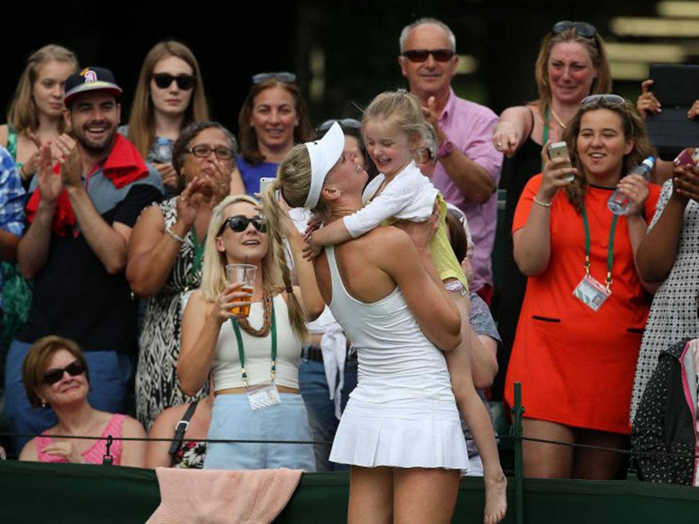 Naomi Broady celebrates her victory with her four-year-old niece Lola