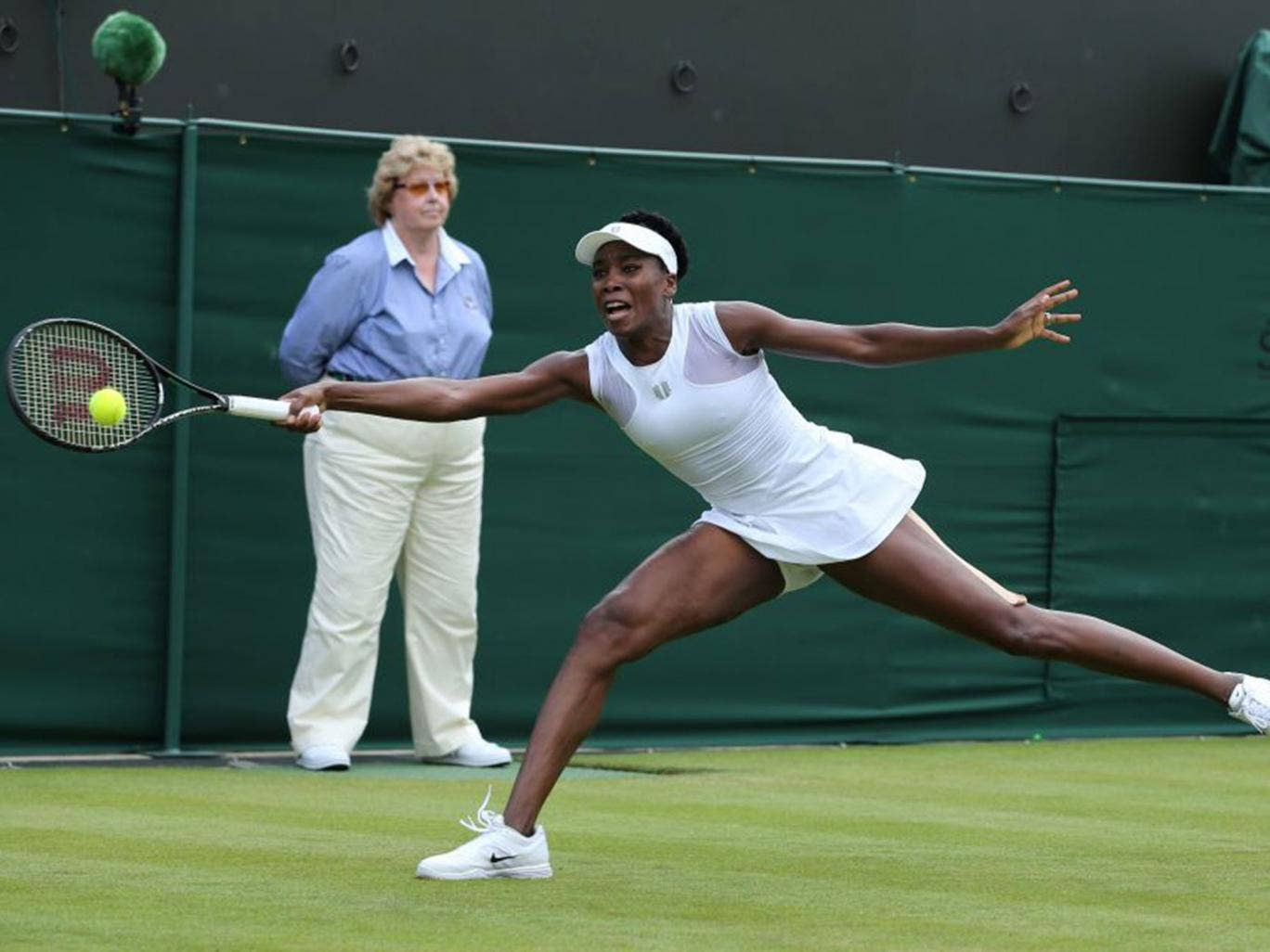 Venus Williams stretches for a return in her  hard-earned first-round win over Maria-Teresa Torro-Flora