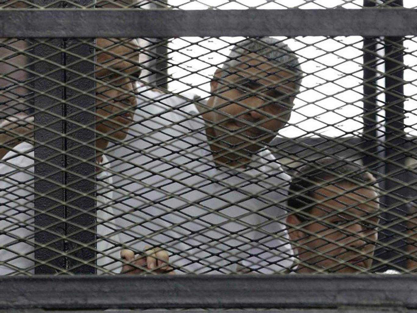 Journalists Peter Greste, left, Mohamed Fahmy,centre, and Baher Mohamed were yesterday jailed for aiding a terrorist organisation. William Hague described the trial as 'unacceptable'