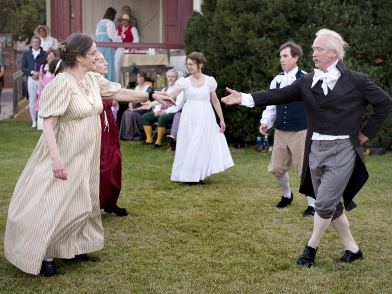 In this June 14, 2014 photo, Dance Discovery members Rebecca Taylor, left, and Tim Hirzel join other members of the troupe in French colonial dance at the Felix Valle House State Historic Site during the annual French Heritage Festival in Ste. Genevieve,