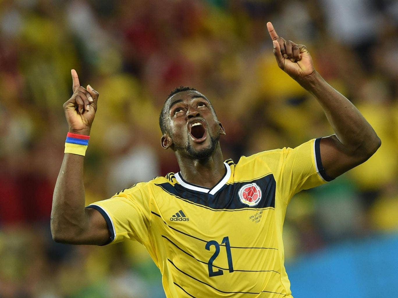 Jackson Martinez celebrates one of his two goals against Japan