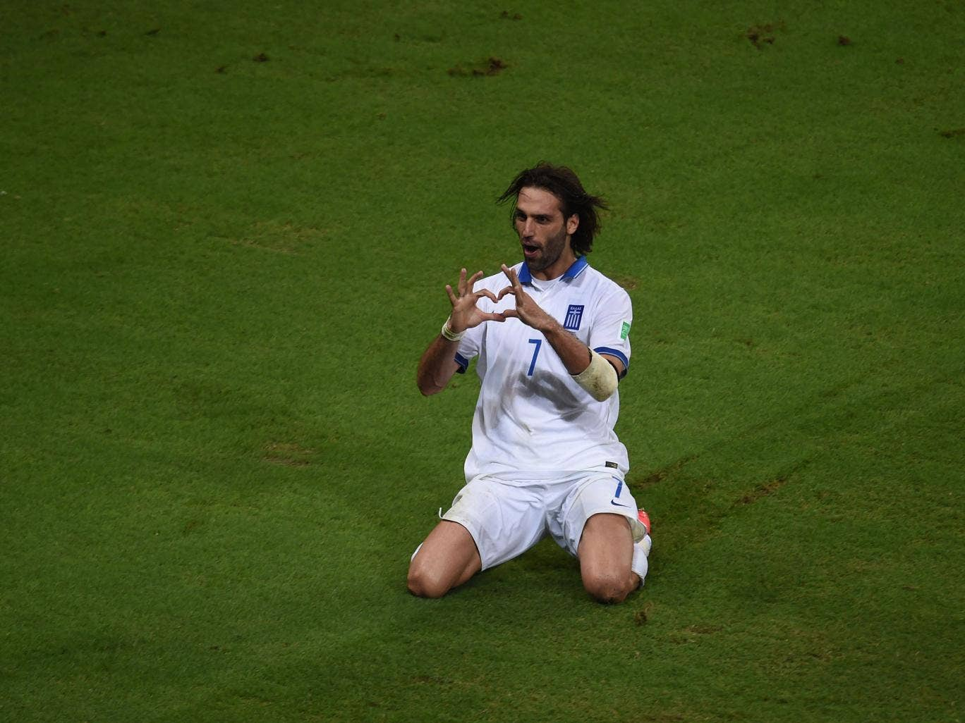 Greece's forward Georgios Samaras celebrates scoring a penalty