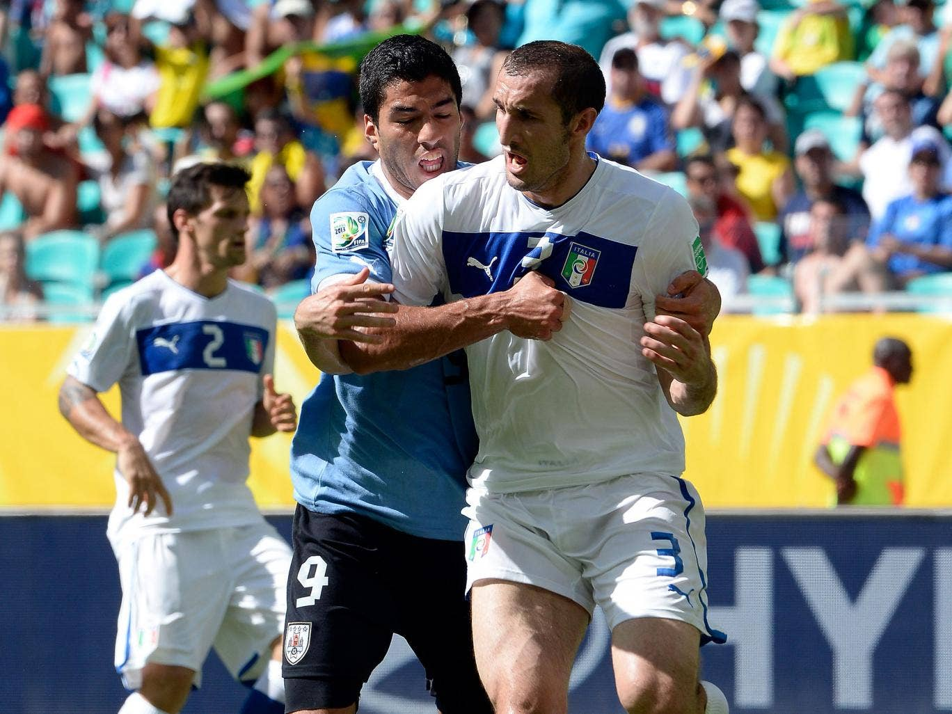 Suarez can be seen trying to bite Chiellini's shoulder during the match
