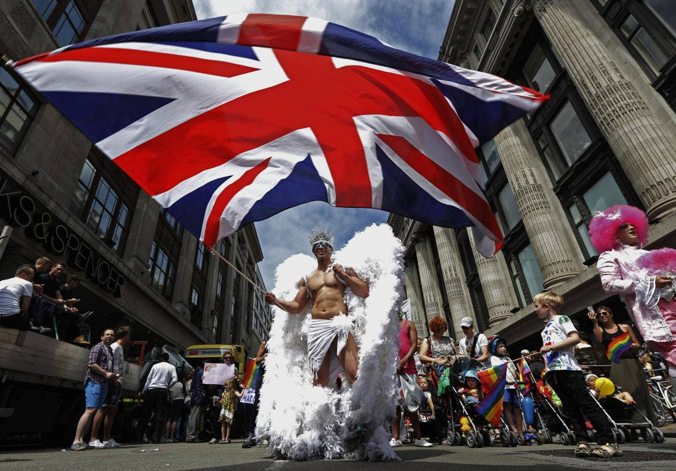 A member of the Pride parade in 2013 proudly waves the British flag