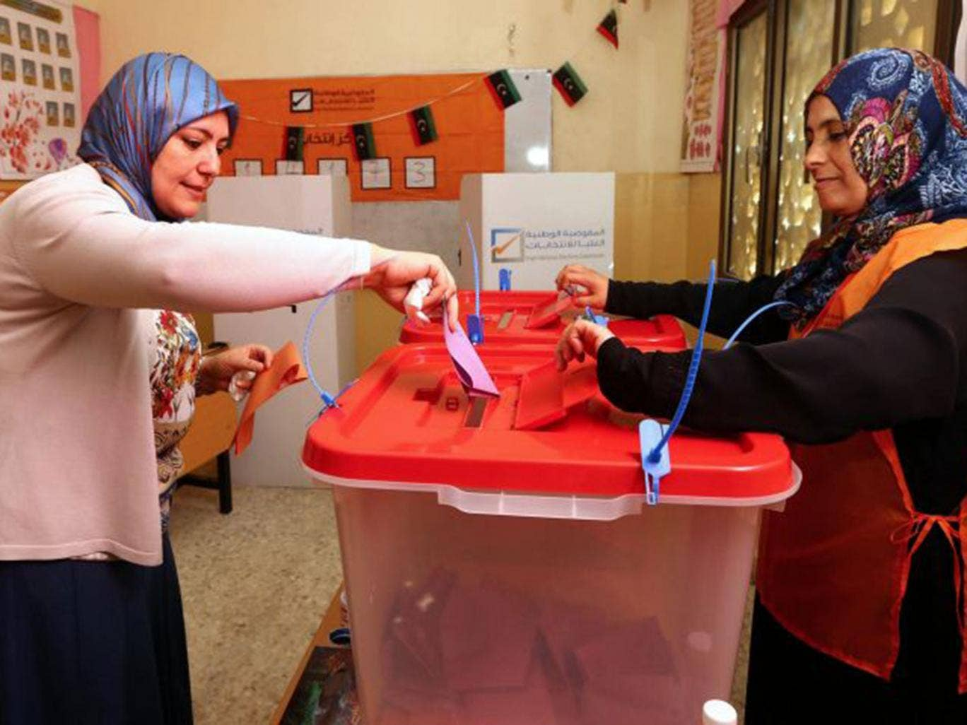 A Libyan woman casts her ballot at a polling station in Tripoli