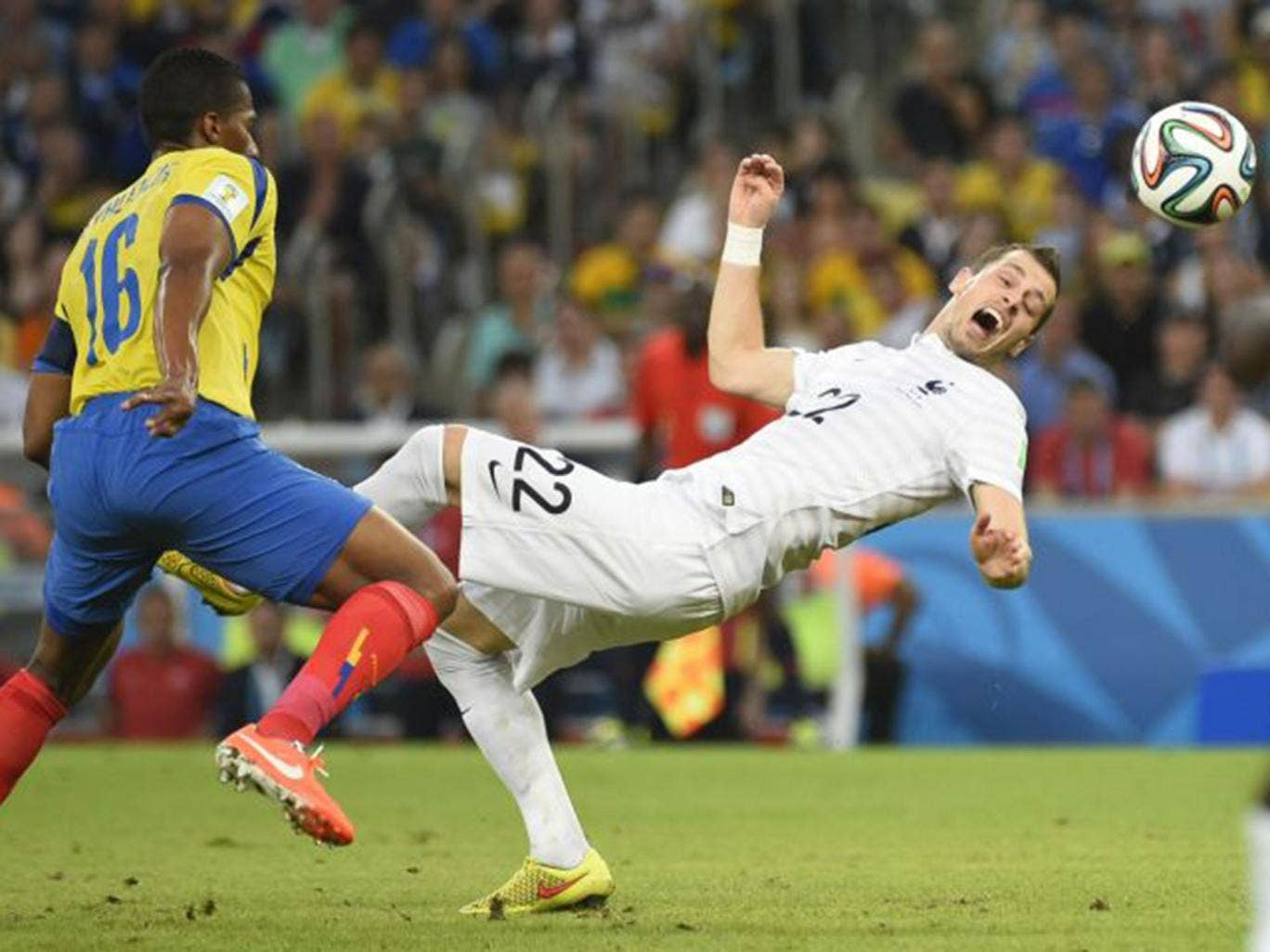 France's Morgan Schneiderlin is challenged by Ecuador's Antonio Valencia at the Maracana