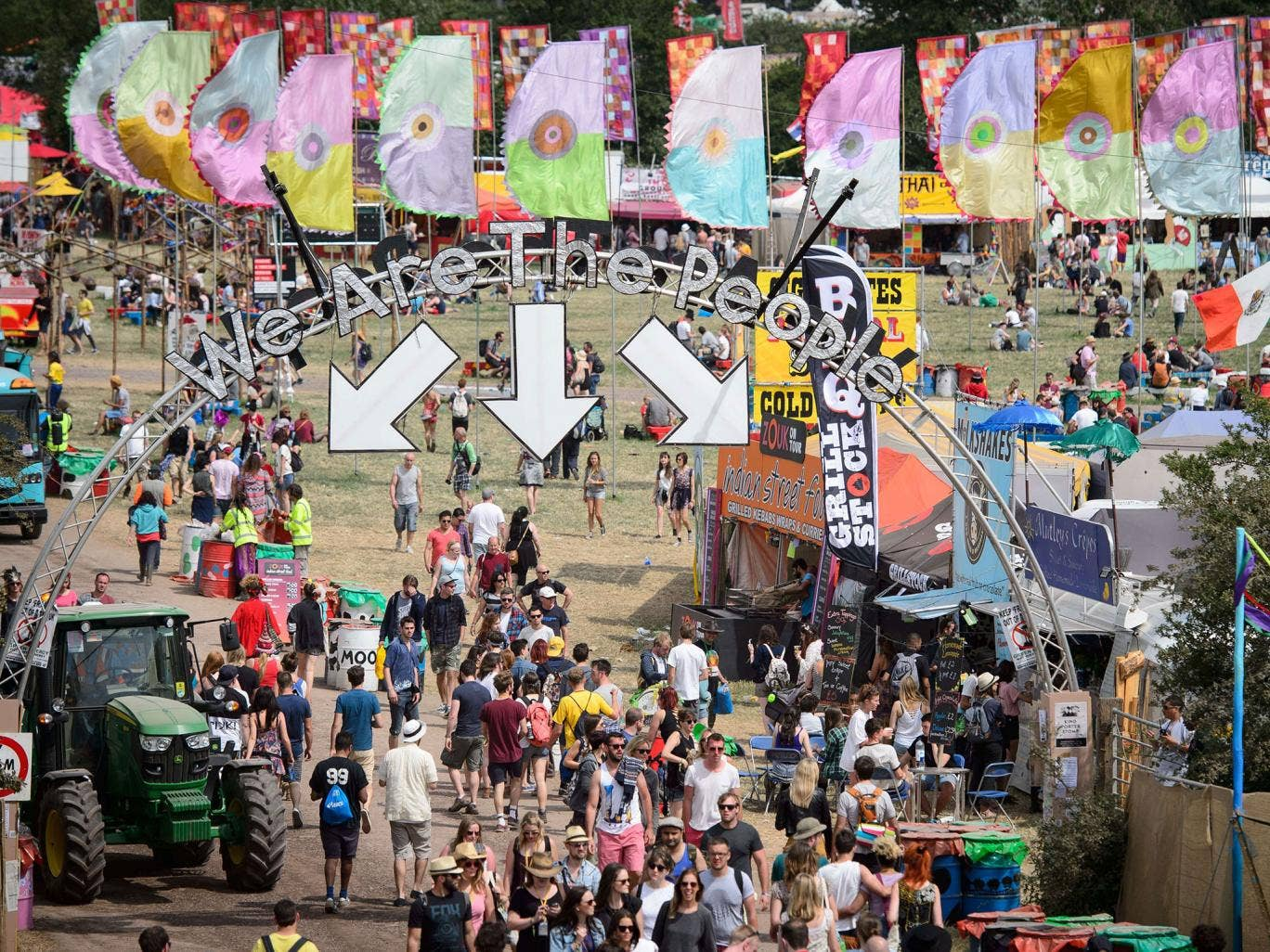 Festival goers enjoy the sun ahead of predicted rain as revellers gather ahead of this weekends Glastonbury Festival of Music and Performing Arts on Worthy Farm near Pilton in Somerset