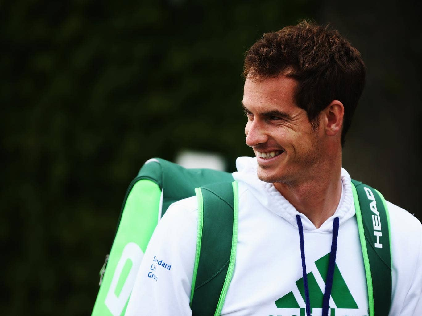 Andy Murray walks out to start a practice session on day four of the Wimbledon Lawn Tennis Championships